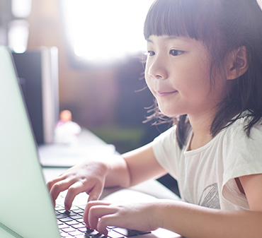 young girl doing activities on a computer